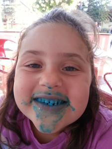 Brenna enjoying some blue ice cream